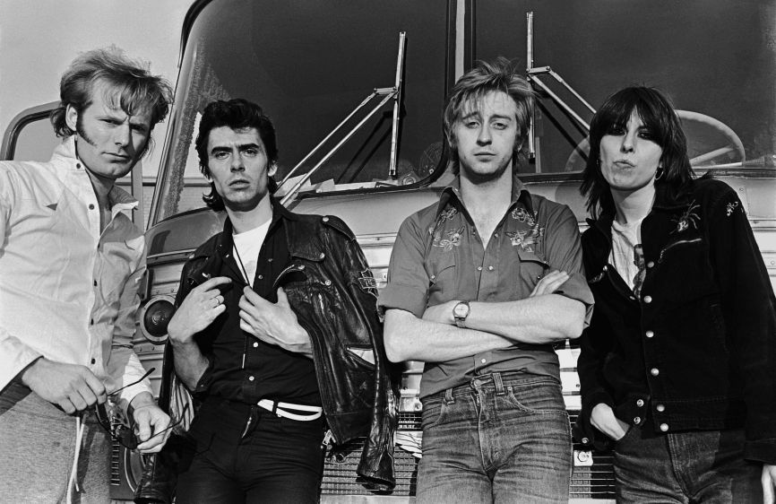 NASHVILLE, TN - 1980: The British rock band The Pretenders pose in front of their tour bus during a 1980 Nashville, Tennessee portrait session. The Pretenders, lead by vocalist Chrissie Hynde, were on their first American tour. (Photo by George Rose/Getty Images) *** Local Caption *** Martin Chambers;Pete Farndon;James Honeyman-Scott;Chrissie Hynde